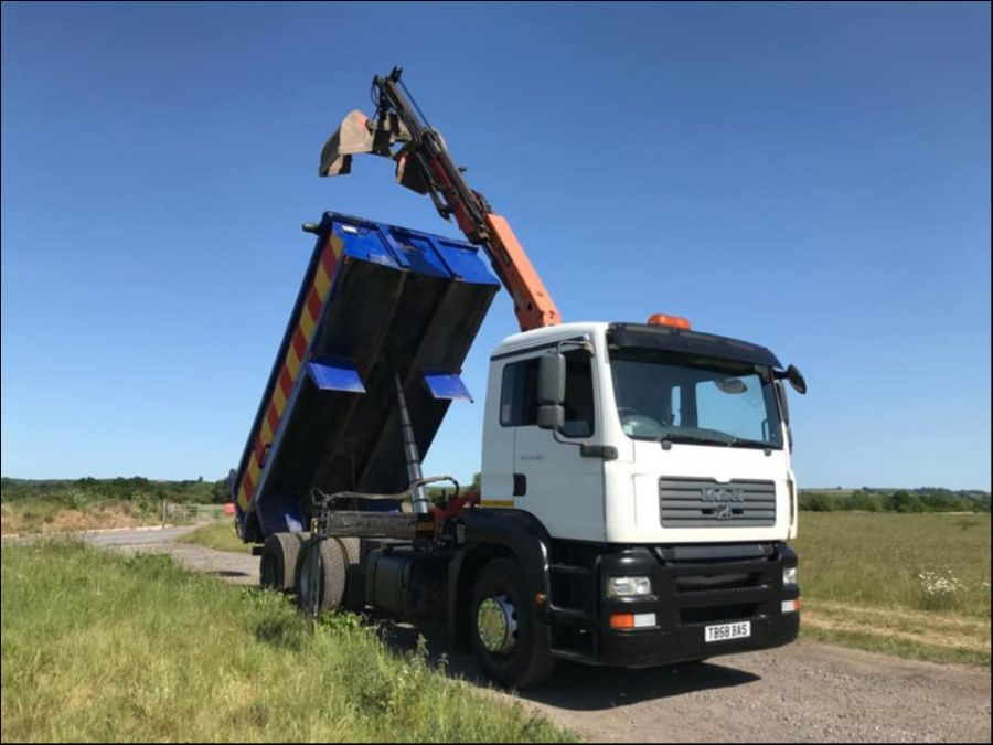 Man Grab Truck Tipper